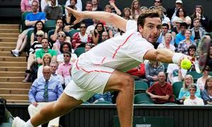 Ernests Gulbis returns to Tomas Berdych during his first-round win against the Czech at Wimbledon