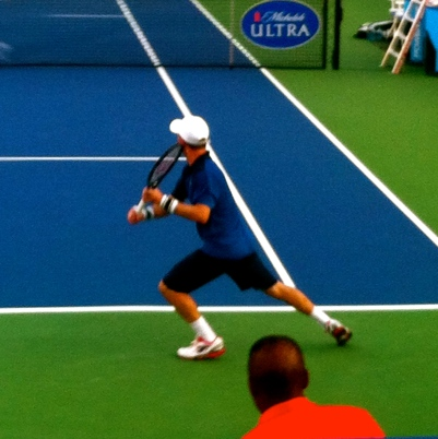 Sela lines up his signature backhand.